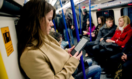 A woman reading Kindle on the Tube.